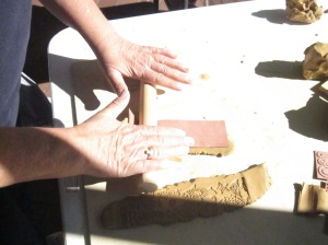 Decorating the clay - rolling on the pattern