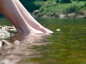 feet in river