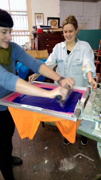 Sarah and one of the fabulous Phillips sisters screen printing our t-shirts