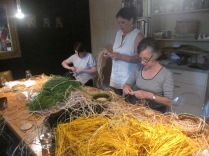 Raffia on the table, with Sarah, Katrina and Libby in action