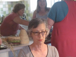 Libby, with some of the other women in the kitchen behind her