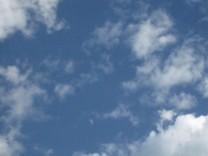 Waning, less than half moon, cloudy sky