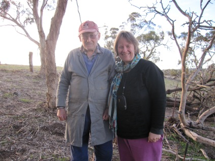 Dad and EB on the hill where mum's ashes are scattered. Dad in his work coat