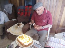 Dad, cat and cake