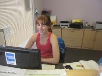 Dana at the desk