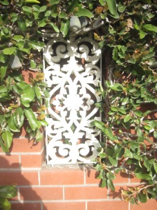 Some wrought iron inset into the wall the climber with the pods is climbing on