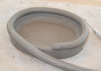 Roll clay into coils to build a curvy pot