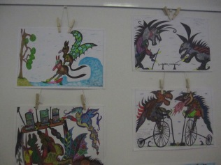 Some of Mark's work (note the two dragons on pennyfarthings playing croquet...