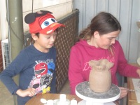 Lucas and Vienna pot making together