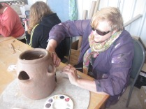 Gail working on the 'strawberry pot'