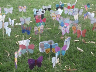Decorated butterflies in the lawn outside of the victory
