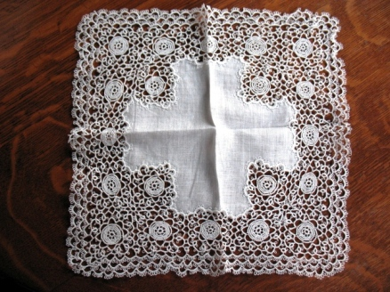 more tatting - the handkerchief would have to be 'a shower not a blower'!