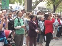 Crowd (including conductor of choir in red)