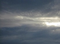 Clouds, sun and plane