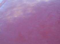 Sky and clouds on a car bonnet
