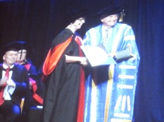 Here is Rhonda getting her certificate thingy from the pro-vice chancellor, whatever that means, John Hill, who used to be the member for Kaurna, down south