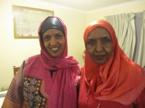 Teyba and Arefa at home afterwards, Teyba in her celebration costume