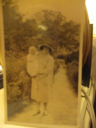 Blurry copy of an old photo of mum as a baby and her mother