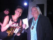 Danielle and Andrea (Andrea winning a raffle prize)