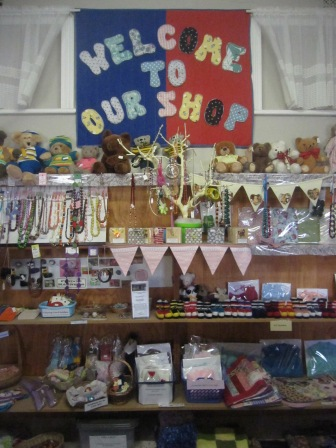 The welcome sign,plus little teddies, bunting, jewellery, bootees in footy colours, etc etc