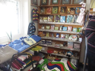 Knitted baby and toddler wear (left), coathangers, flannels and soaps, hand made dolls, cushions etc etc