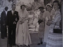 Dad and mum and spectators looking glorious in 1950's finery