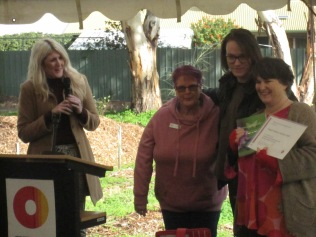 Erin the Mayor, with Jill, Sam and Debbie, receiving certificate of appreciation and butterfly book from the mayor