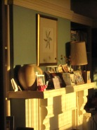 Early morning sun shining on the mantlepiece