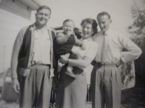 Alec Russell, with his son Stephen being held by my mum, with dad on the right. Taken in the 1950s.