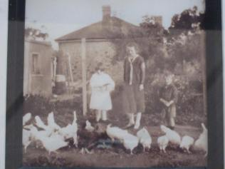 Photo of the photo - Joan, mum (Dossie, my nana), and Walter (aka Ric, dad), plus all those chooks. Taken in Saddleworth in around 1927