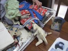 Pam's treasure trove, including the kangaroo that was sent to her by a cousin who went to Australia at the same time as Anni's family went to the US. The photo also shows a picture of Pam's daughter in the red and blue dress that was originally Pam's mum Anni's