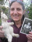 Pam now holding kanga in one hand and a photo of herself when young holding kanga