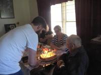 Lighting birthday cake 2 with grandson Jarryd and granddaughter Leigh