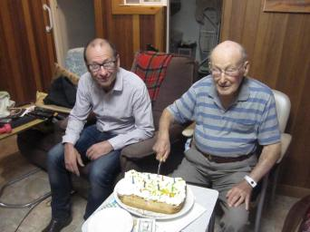 Richard and dad at the cutting of the cake