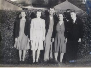 Dad's family (the only picture we have of all of them) - Maureen (younger sister), Joan, his father and mother (Dick and Dossie), Leo in the shadow at the back and dad at the end. Taken in the 1940's
