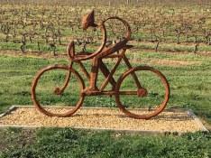 Bike rider sculpture