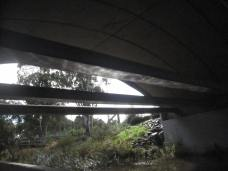 Reflection of the creek on the underside of the overpass (sun contorted)